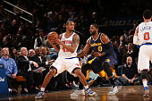Lance Thomas of the New York Knicks handles the ball against CJ Miles of the Indiana Pacers on April 8 2015 at Madison Square Garden in New York City...