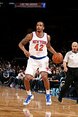 Lance Thomas of the New York Knicks handles the ball against the San Antonio Spurs on March 17 2015 at Madison Square Garden in New York City NOTE TO...