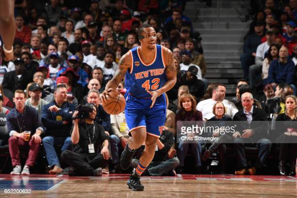 Lance Thomas of the New York Knicks handles the ball during a game against the Detroit Pistons on March 11 2017 at The Palace of Auburn Hills in...