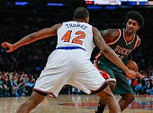 Lance Thomas of the New York Knicks in action against OJ Mayo of the Milwaukee Bucks at Madison Square Garden on April 10 2015 in New York New York
