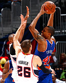 Lance Thomas of the New York Knicks is trapped by Al Horford and Kyle Korver of the Atlanta Hawks at Philips Arena on April 13 2015 in Atlanta...