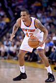 Lance Thomas of the New York Knicks looks to make a move with the ball against the Golden State Warriors at ORACLE Arena on March 14 2015 in Oakland...