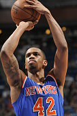 Lance Thomas of the New York Knicks prepares to shoot a free throw against the Orlando Magic on April 11 2015 at Amway Center in Orlando Florida NOTE...
