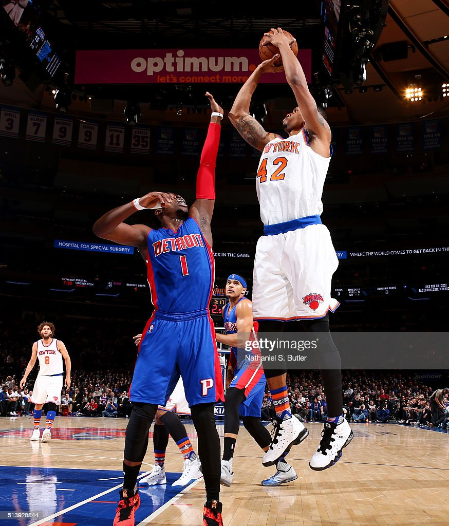 Lance Thomas of the New York Knicks shoots against Reggie Jackson of the Detroit Pistons on March 5 2016 at Madison Square Garden in New York City...