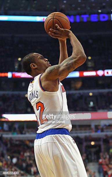 Lance Thomas of the New York Knicks shoots against the Chicago Bulls at the United Center on March 28 2015 in Chicago Illinois The Bulls defeated the...