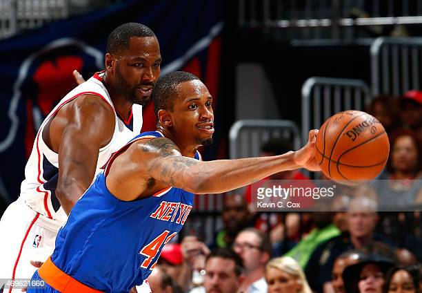 Lance Thomas of the New York Knicks steals the ball from Elton Brand of the Atlanta Hawks at Philips Arena on April 13 2015 in Atlanta Georgia NOTE...