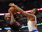 Lance Thomas of the New York Knicks stops Jimmy Butler of the Chicago Bulls from getting off a shot at the United Center on March 28 2015 in Chicago...