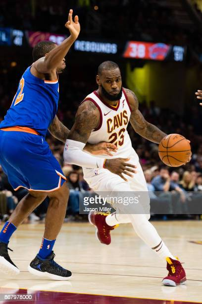 Lance Thomas of the New York Knicks tries to stop LeBron James of the Cleveland Cavaliers during the second half at Quicken Loans Arena on October 29...