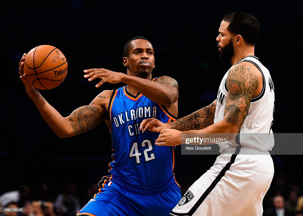 Lance Thomas of the Oklahoma City Thunder attempts to pass around Deron Williams of the Brooklyn Nets at the Barclays Center on November 3 2014 in...