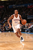 Lance Thomas of the Oklahoma City Thunder drives to the basket against the Golden State Warriors on November 23 2014 at the Chesapeake Energy Arena...