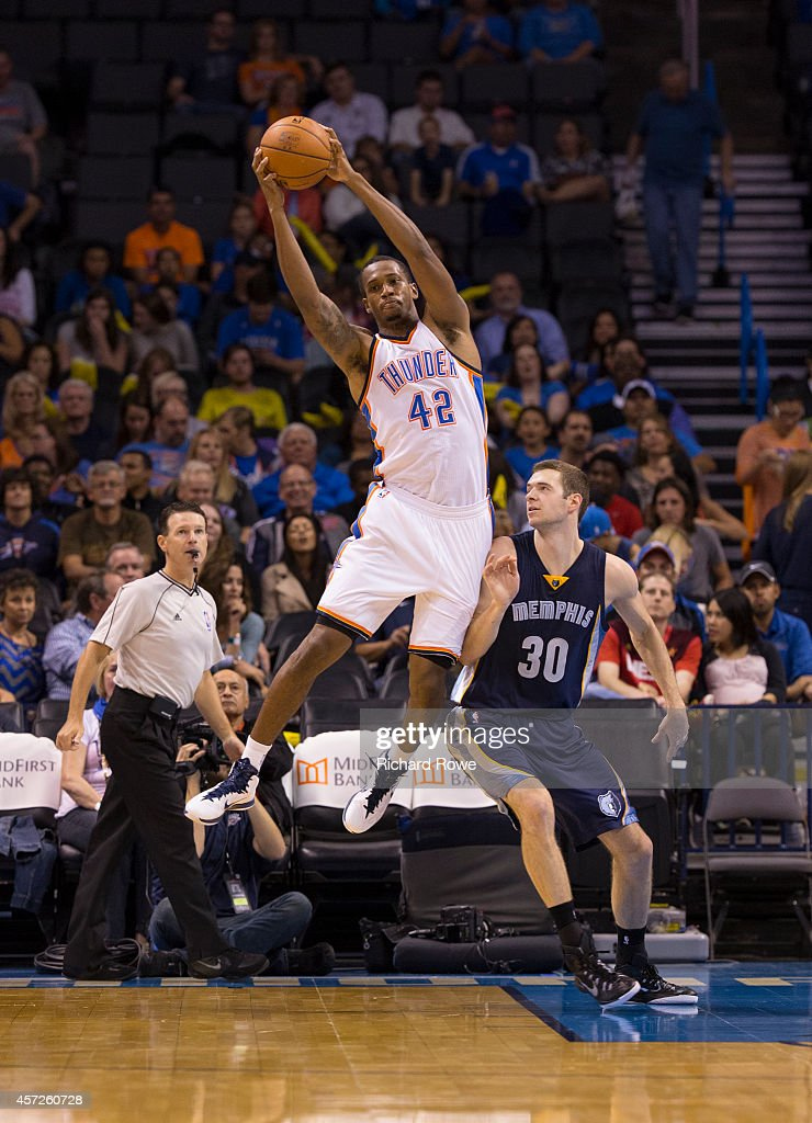 Lance Thomas of the Oklahoma City Thunder grabs the rebound against the Memphis Grizzlies at the Chesapeak Energy Arena on October 14 2014 in...