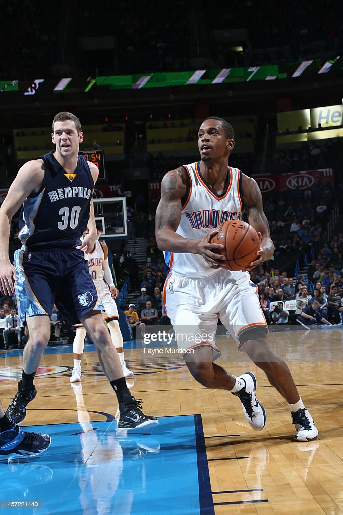 Lance Thomas of the Oklahoma City Thunder handles the ball against the Memphis Grizzlies at the Chesapeake Energy Arena on October 14 2014 in...