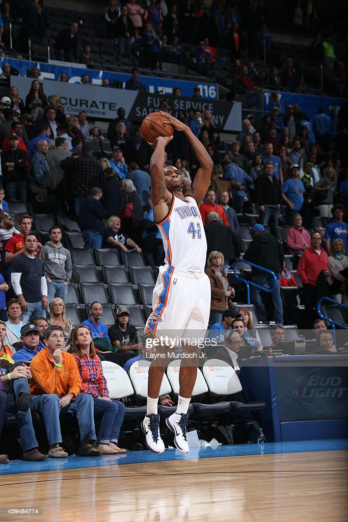 Lance Thomas of the Oklahoma City Thunder shoots against the Golden State Warriors on November 23 2014 at the Chesapeake Energy Arena in Oklahoma...