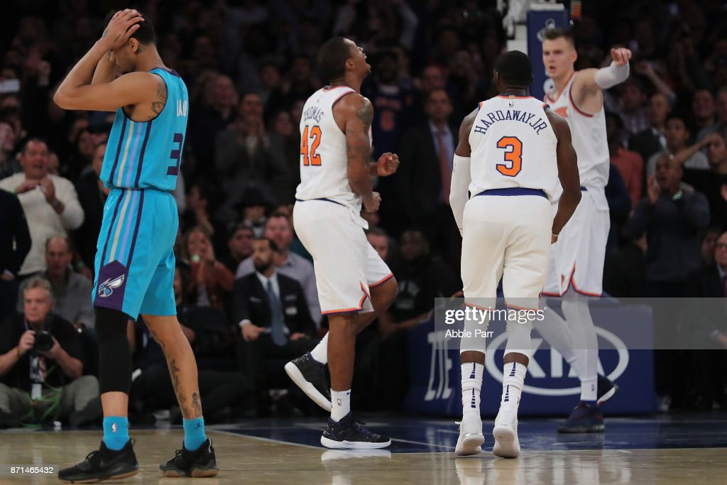 Lance Thomas #42 (L), Tim Hardaway Jr. #3, Kristaps Porzingis #6 of the New York Knicks and Jeremy Lamb #3 of the Charlotte Hornets react after the Knicks gain control of the game late in the fourth quarter during their game at Madison Square Garden on November 7, 2017 in New York City.