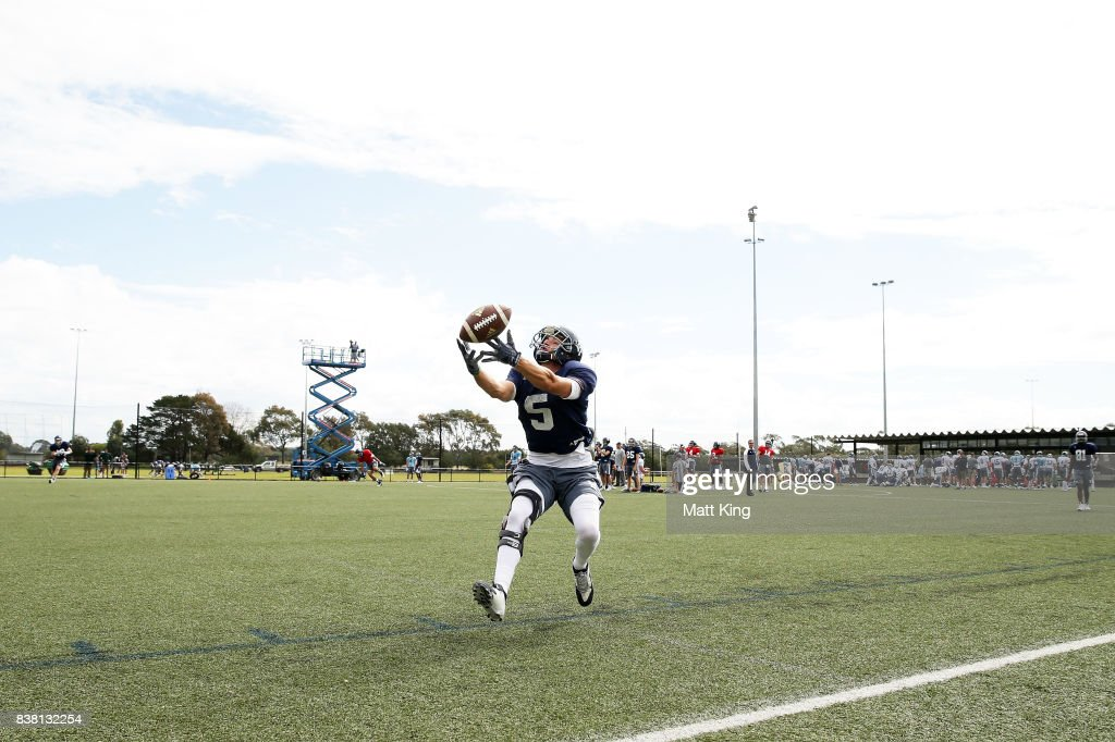 Lance Wright attempts a catch during a Rice University College Football training session at David Phillips Sports Complex on August 24, 2017 in Sydney, Australia.