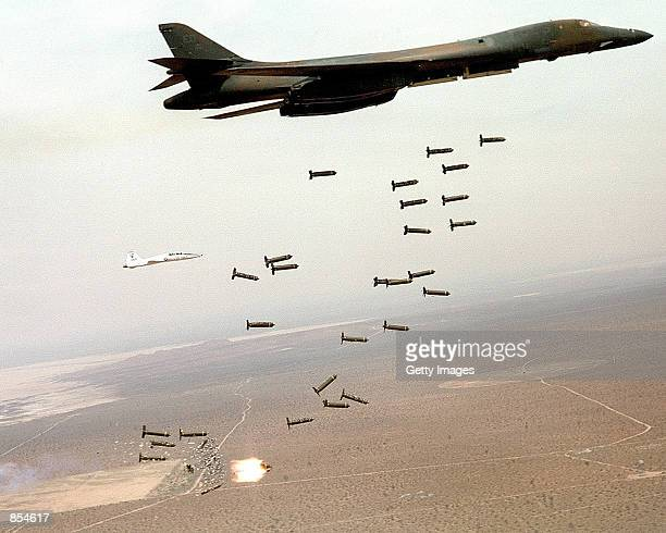 A B1B Lancer from the US Air Force 28th Air Expeditionary Wing drops arsenal while on a combat mission in support of strikes on Afghanistan in this...