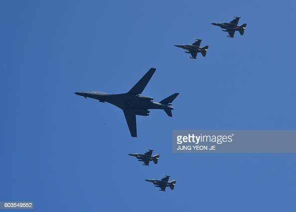 Lancer is escorted by US F16 fighter jets as it flies over the Osan Air Base aiming at reinforcing the US commitment to its key ally in Pyeongtaek on...