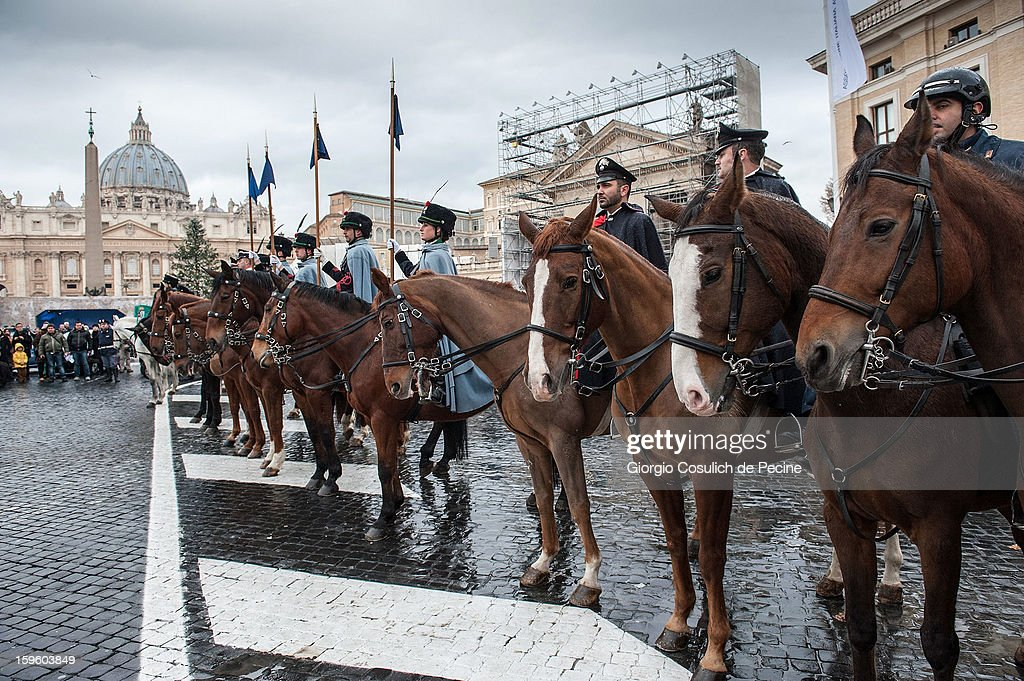 Lancers of Montebello sit on their horses in front of the Saint Peter Basilica, during a traditional day of blessing of the animals, on January 17, 2013 in Vatican City, Vatican. Every year, during the feast of St. Anthony the Abbot, the traditional blessing of the animals is celebrated.