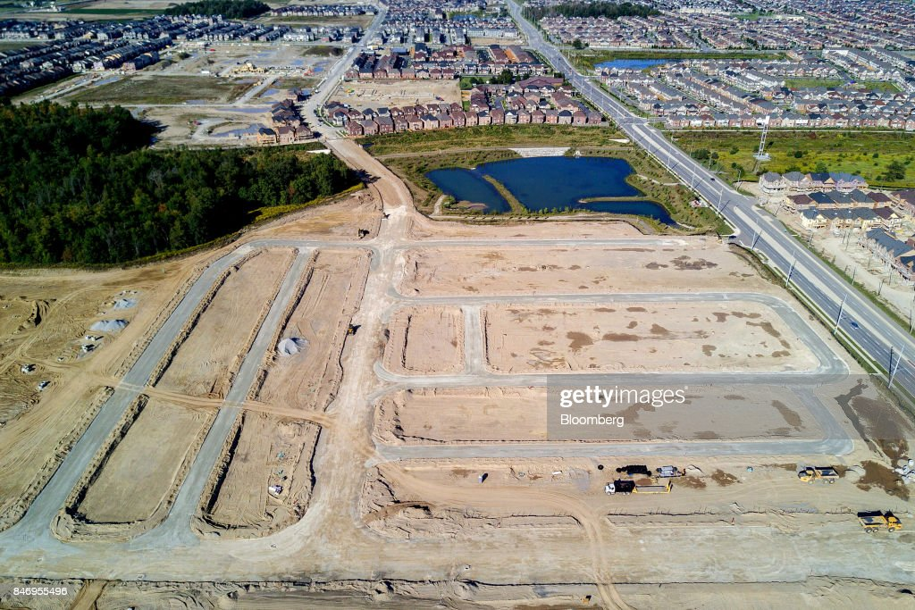 Land allotted for new homes near a construction site in this aerial photograph taken above Brampton, Ontario, Canada, on Saturday, Sept. 9, 2017. Toronto home builders are showing no signs of concern about the city's housing market. New construction has averaged just over 42,000 annualized between January and August, the highest first eight months of a year since 2012. Photographer: James MacDonald/Bloomberg via Getty Images
