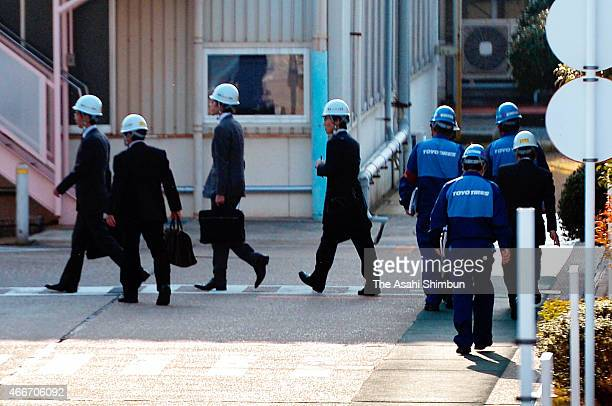 Land Infrastructure Transport and Tourism ministry officials arrive at the Toyo Tire Rubber Akashi factory to investigate on March 17 2015 in Inami...