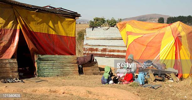 STORY ' Land issue rears its head in royal enclave of Swaziland' Busiswe Mkhabela and her children pose on August 3 2011 under a tarpaulin in a tent...
