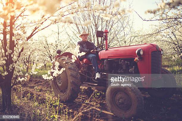 Land owner driving a tractor