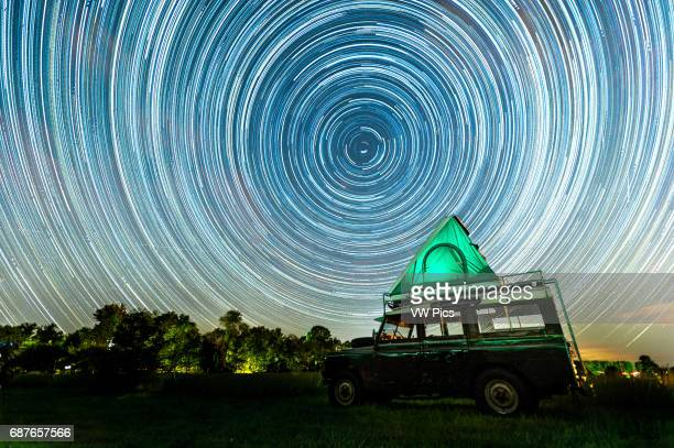 Land Rover at night with moving stars in the sky in Fallston Maryland USA