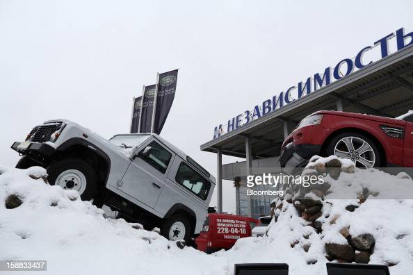 Land Rover automobiles stand on display surrounded by snow outside an independent auto showroom in Moscow Russia on Friday Dec 28 2012 Tata Motors...