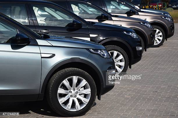 Land Rover cars in a row