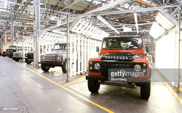 Land Rover Defender automobiles sit in a final inspection area at Tata Motors Ltd's Jaguar Land Rover vehicle manufacturing plant in Solihull UK on...