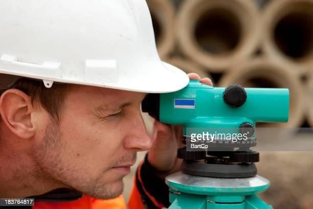 Land surveyor on construction site The Netherlands