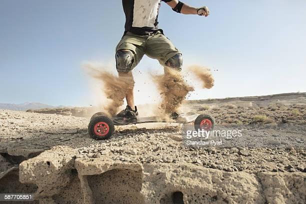 Landboarder in dust cloud