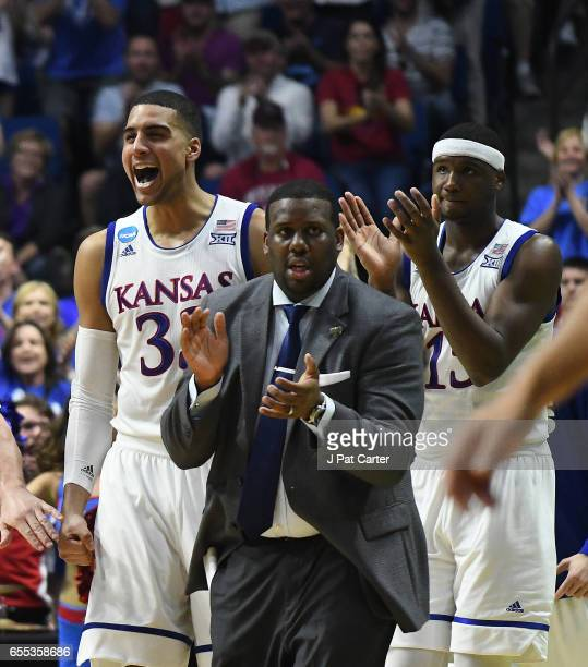 Landen Lucas assistant coach Jerrance Howard and Carlton Bragg Jr #15 of the Kansas Jayhawks celebrate the play against the Michigan State Spartans...