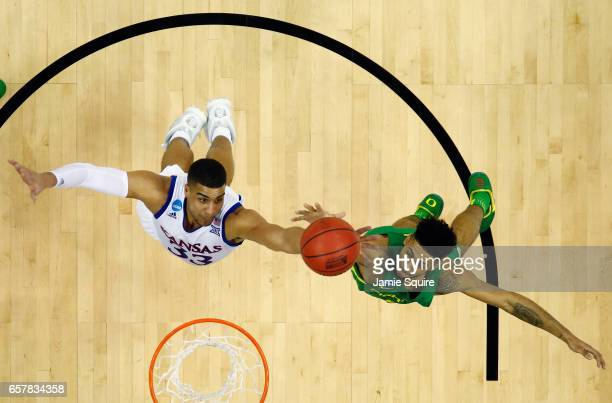 Landen Lucas of the Kansas Jayhawks and Tyler Dorsey of the Oregon Ducks battle for the ball during the 2017 NCAA Men's Basketball Tournament Midwest...