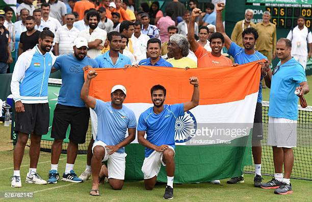 Lander Paes Rohan Bopanna Ramkumar Ramanathan Saketh Myneni Anand Amritraj Coach Zeeshan Ali and other Indian team celebrating the victory against...