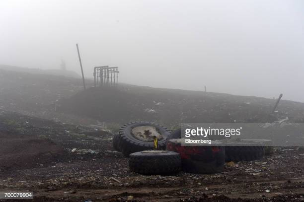 A landfill gas extraction wellhead stands beyond rubber tires in a landfill cell at the Melbourne Regional Landfill site operated by Cleanaway Waste...
