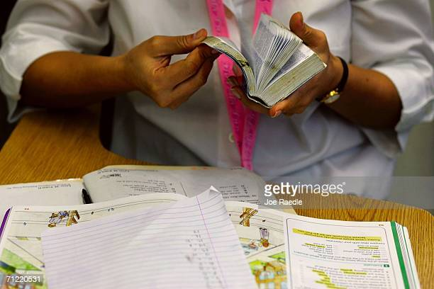Landi Rojas from Ecuador looks through her English/Spanish dictionary as she sits in class at the English Center June 16 2006 in Miami Florida The...