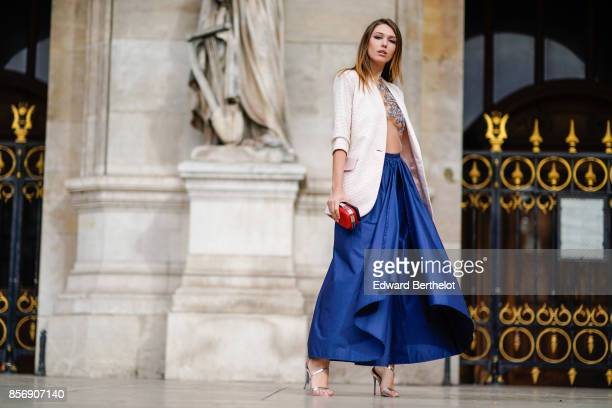 Landiana wears a white blazer a mesh top blue skirt outside Stella Mccartney during Paris Fashion Week Womenswear Spring/Summer 2018 on October 2...