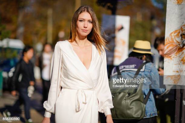 Landiana wears a white dress outside Chanel during Paris Fashion Week Womenswear Spring/Summer 2018 on October 3 2017 in Paris France