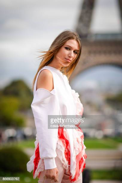 Landiana wears a white top outside Hermes during Paris Fashion Week Womenswear Spring/Summer 2018 on October 2 2017 in Paris France