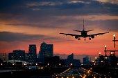 Landing airplane at dusk