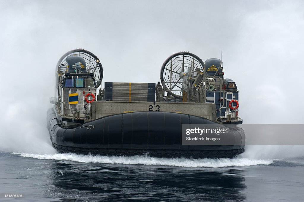 A landing craft air cushion approaches the well deck of USS New Orleans.