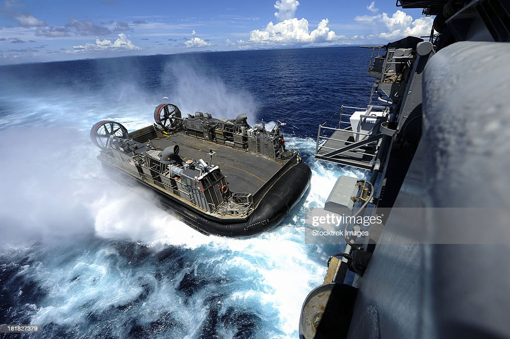 A landing craft air cushion enters the well deck of USS Bonhomme Richard.