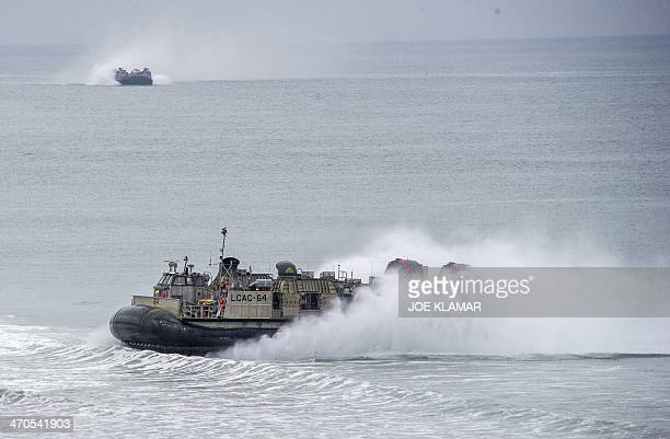 Landing Craft Air Cushions with Assault Craft Unit 5 transport US Marines sailors and soldiers from the Japan Ground SelfDefense during the US JAPAN...
