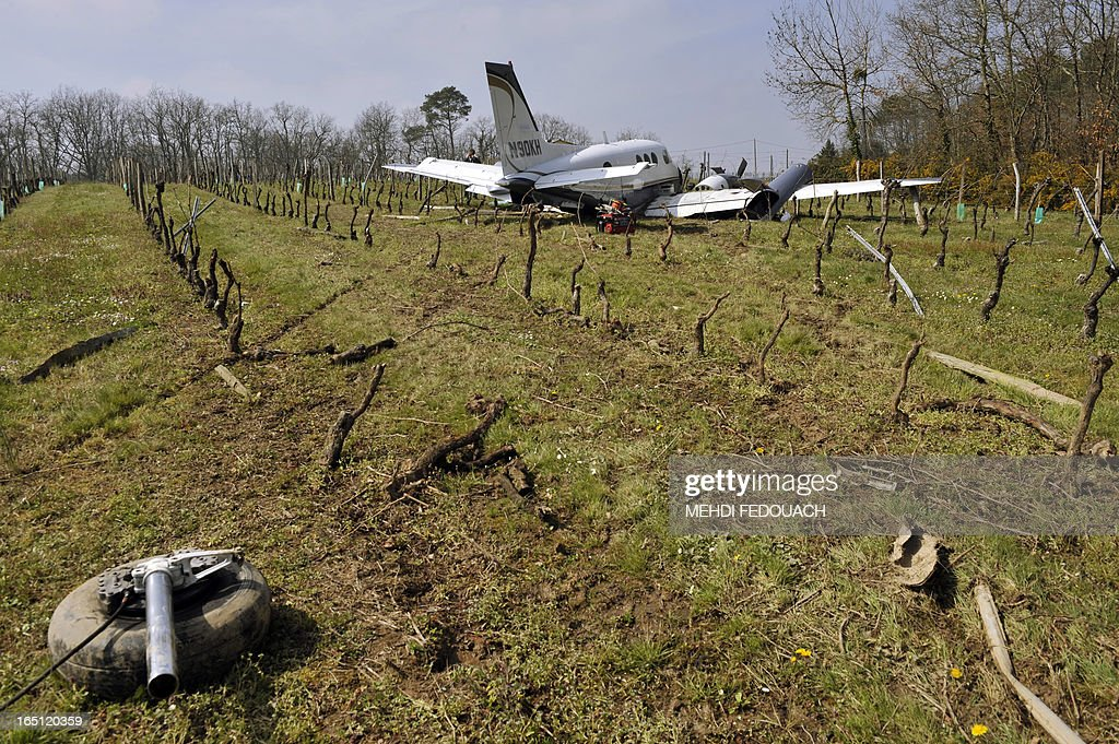 Landing gear is pictured near a damaged Beechcraft 90 resting in a vinyard on March 31, 2013 near Sainte-Radegonde in France's south west after the pilot was forced to land among the vines following a mechanical problem after mid-day on March 29. The pilot and passenger who were travelling back to their Dordogne base walked away from the accident.