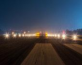 Landing lights at night closeup.