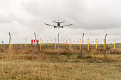 Landing of a large civil aircraft over the landing lights of the airfield, rear view