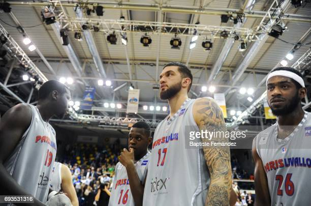 Landing Sane Frederic Loubaki Vincent Poirier and Cyrille Eliezer Vanerot of Paris Levallois look dejected during the Pro A PlayOff match between...