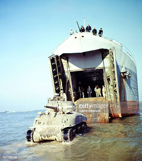 Landing Ship Tank And Sherman An American Sherman Tank M4A1W is rolling out of the Landing Ship Tank July 1944 The invasion of France is underway and...