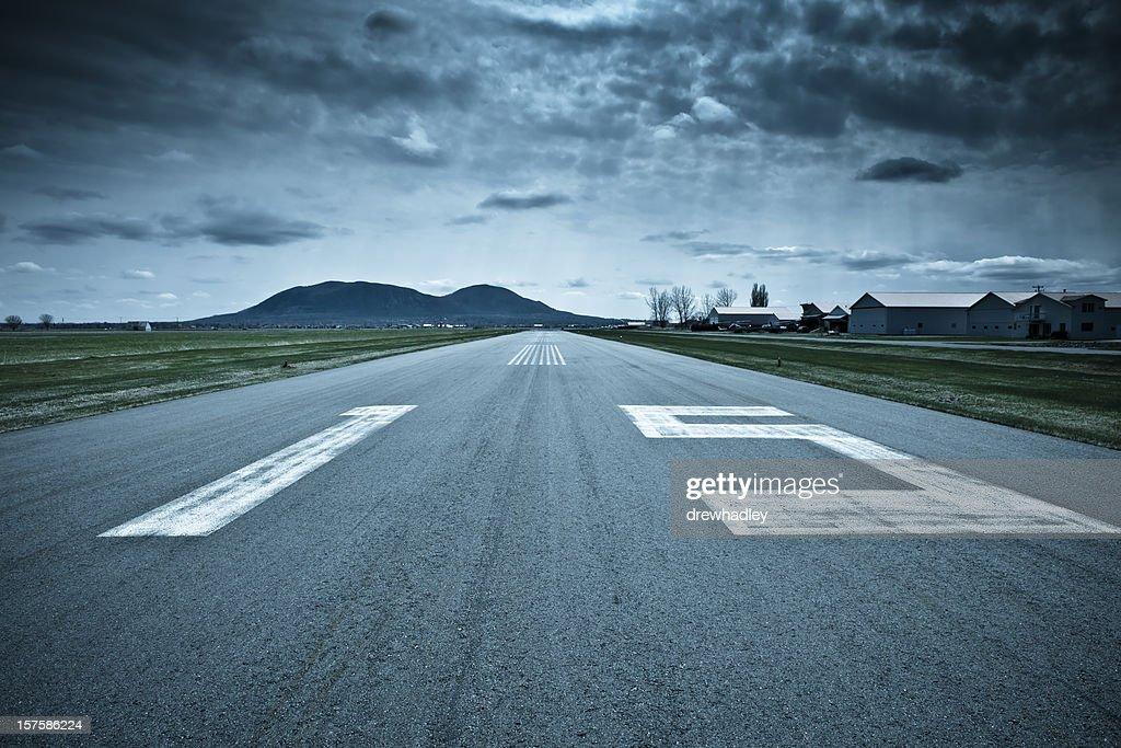 Landing strip, runway. Dramatic weather.